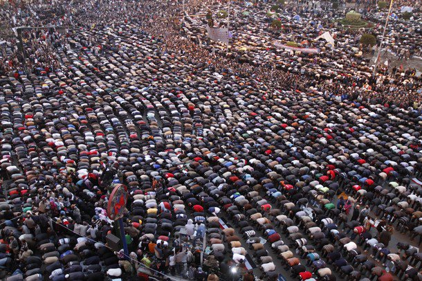 When young Egyptian prayed Friday in Tahrir Square