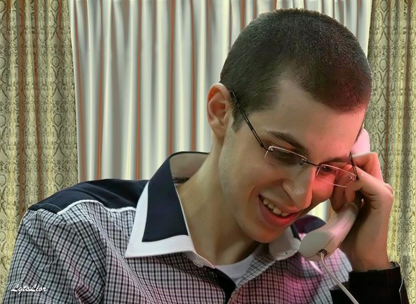 Gilad Shalit on phone with his parents...