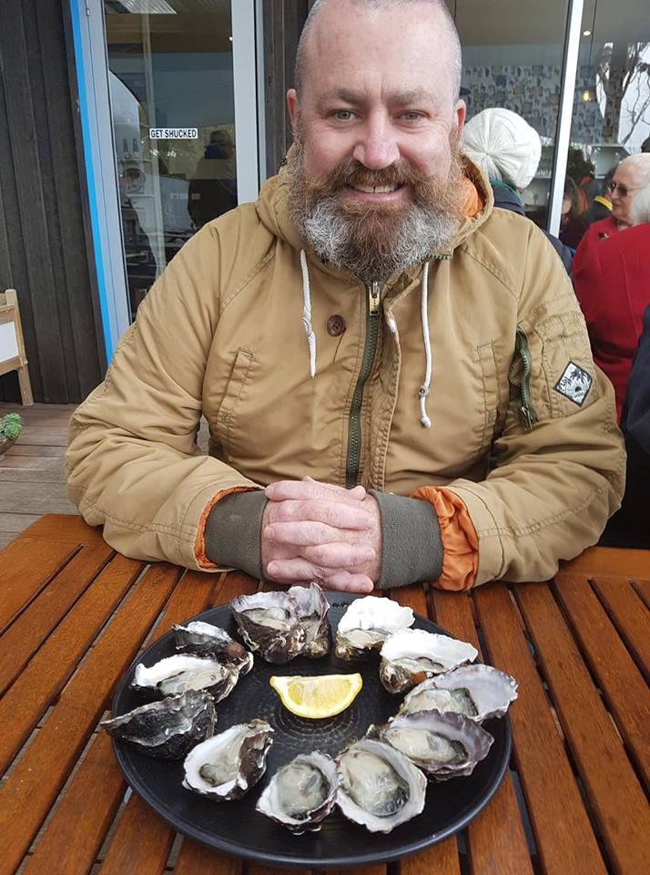 Eating fresh oysters in Tasmania.