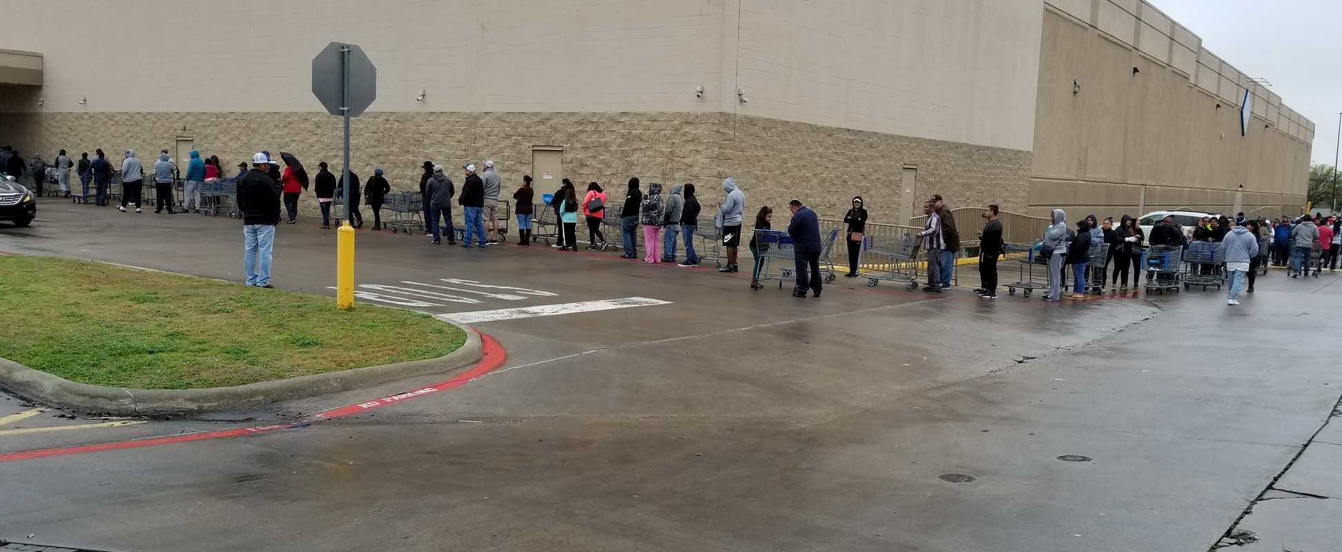 people lined up at a big box club store